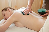 Green clay body skin theraphy massage, woman