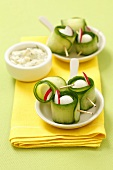 Cucumber rolls with quail's eggs and radishes