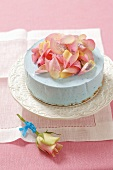A blue cheesecake with rose petals