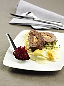 Meat loaf with mashed potato and grated beetroot