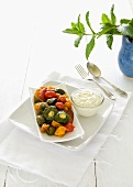 Oven baked summer vegetables with a feta-mint dressing