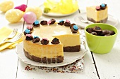 Cheese cake with chocolate-covered plums for Easter