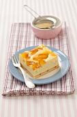 A slice of peach cheesecake