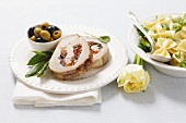 Pork roulade filled with dried tomatoes and olives