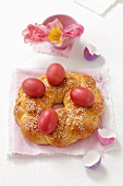 A sweet bread wreath with Easter eggs and sugar sprinkles