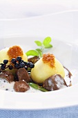 Venison ragout with potato dumplings and elderberries