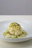 Cauliflower with a herb crust on creamy potatoes