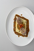 Veal roulade with coloured lentils on pasta