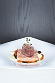 Saddle of lamb with a rhubarb and cucumber medley and a spicy sauce