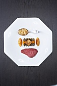 Pigeon breast with tea, pumpkin puree and goose liver