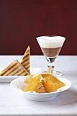 A trio of desserts: chocolate mousse, caramel ice cream and banana toast