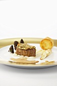 Veal filler with an artichoke crust, asparagus, morel mushrooms and potato roulade