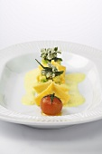Avocado and prawn ravioli with curry sauce and baked curry plant