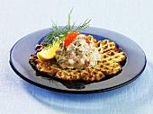 Waffles with crayfish salad and caviar