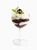 Quark cream with blackberries and pistachios