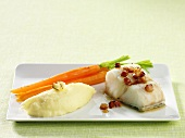 Fish fillet with bacon, mashed potatoes and carrots