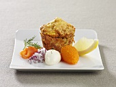 Spicy muffin with salmon, onion, caviar and lemon