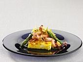 Saffron cake with a prawn and asparagus salad