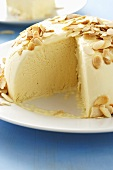 A vanilla ice cream bomb with slivered almonds
