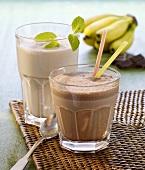 Chocolate shake with straws and a banana shake