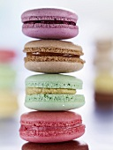 A stack of four colourful macaroons