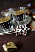 Star-shaped Spekulatius (German Christmas biscuits) and glasses of espresso
