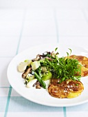 Rösti with vegetable ragout and garden cress