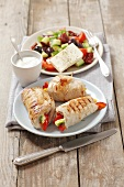 Grilled turkey breast roulade filled with peppers with a dip and a salad