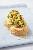 A slice of bread topped with avocado chilli cream