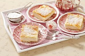 Puff pastry cakes with a cream filling
