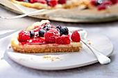 A slice of mascarpone tart with fresh berries