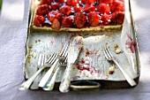Strawberry and vanilla cake on a baking tray