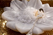 Fleur de sel and a spoon in a flower-shaped bowl