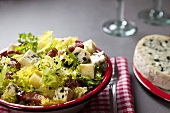Mixed leaf salad with cheese and bacon from Auvergne (France)