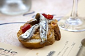 White bread with anchovies and pepper in a restaurant