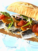 Sardine, goat's cheese and tomato confit sandwich