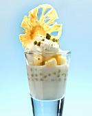 Vanilla panna cotta with pineapple ragout and coconut ice cream