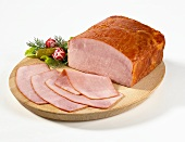 Sliced country ham on a wooden plate