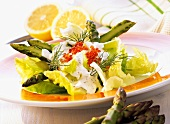Green asparagus salad with sour caviar cream