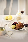 Roast goose leg with potato dumplings and red cabbage