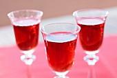 Three glasses of cherry liqueur