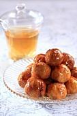 Fried dough balls with rum sauce (Arabia)