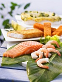 Salmon fillet, prawns and fish fingers
