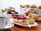 Various type of fresh and frozen cakes and a cup of coffee