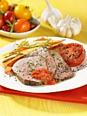 Sliced roast veal fillet with vegetables