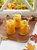 Peach punch in three glass cups