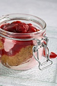 Raspberry charlotte in a preserving jar