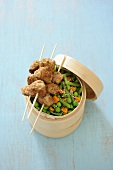 Breaded veal kebabs with bran and steamed vegetables