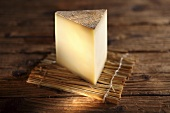 A slice of Greyerzer, Swiss hard cheese