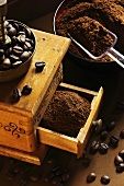 Whole and ground coffee beans from a hand coffee grinder